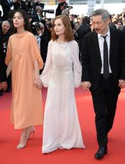"CANNES, FRANCE - MAY 21: (L-R) Kim Minheet, Isabelle Hupert and director Hong SangSoo of 'Claire's Camera (Keul-Le-Eo-Ui-Ka-Me-La)' walk the red carpet ahead of the ""The Meyerowitz Stories"" screening during the 70th annual Cannes Film Festival at Palais des Festivals on May 21, 2017 in Cannes, France. (Photo by Venturelli/WireImage)"